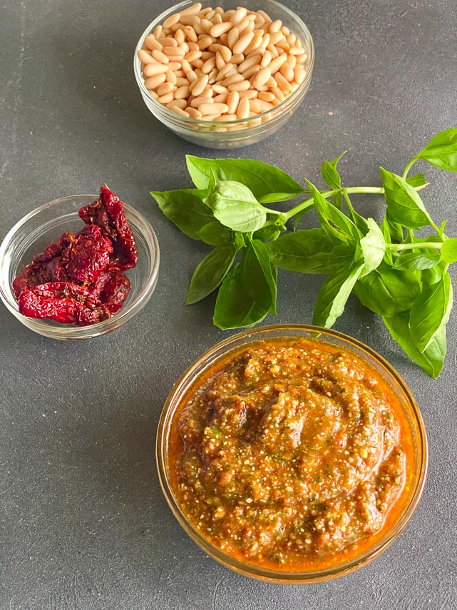 ingredients for low FODMAP sundried tomato pesto on gray surface