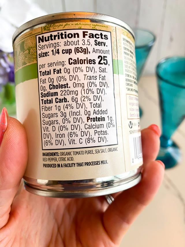 label of canned tomato sauce, held in hand. Look for No onions and No garlic