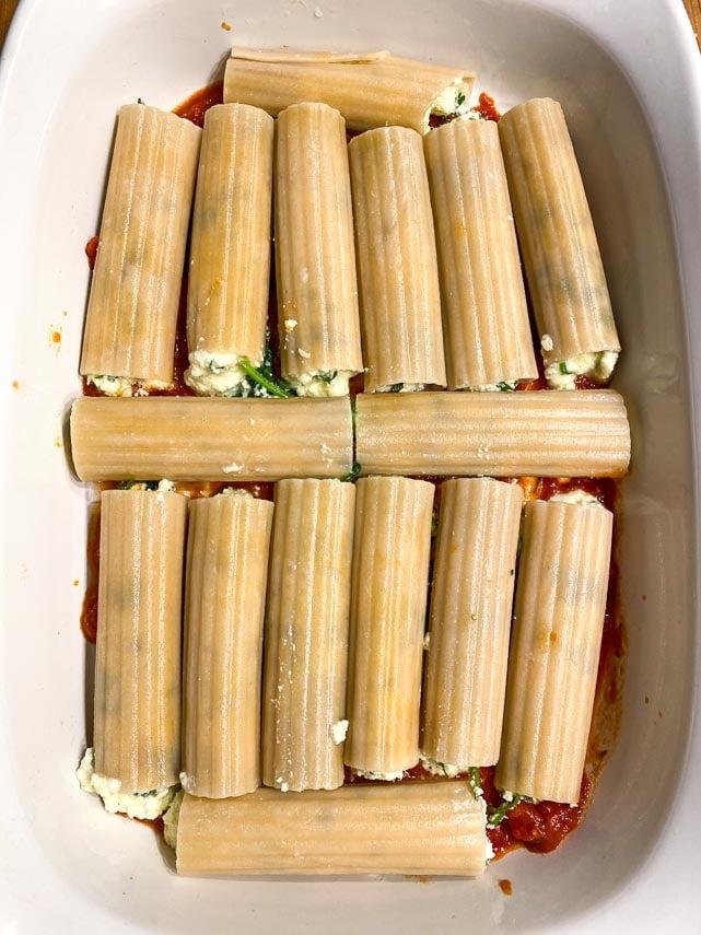 manicotti nestled in baking dish