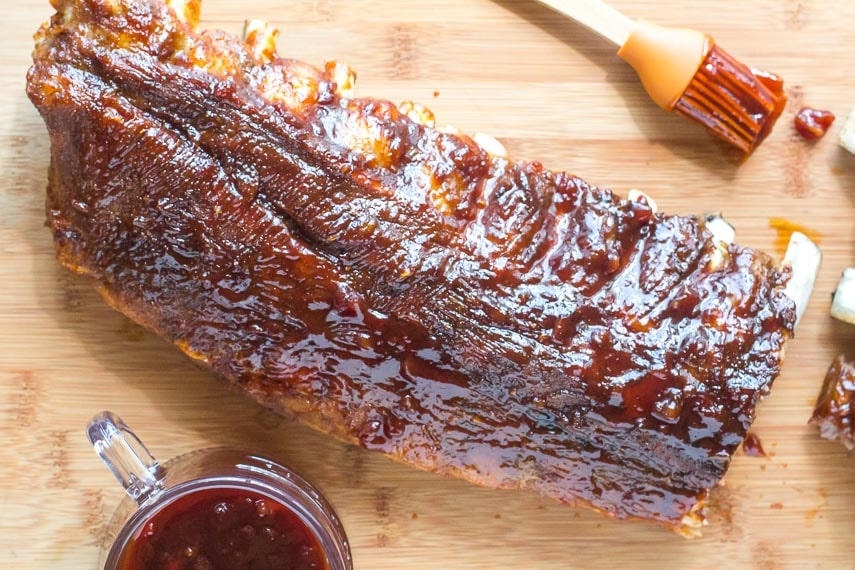 overhead Low FODMAP Pineapple Whiskey BBQ Ribs on wooden board