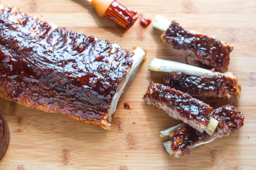 overhead closeup of Low FODMAP Pineapple Whiskey BBQ Ribs on wooden board