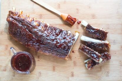 overhead view of Low FODMAP Pineapple Whiskey BBQ Ribs on wooden board