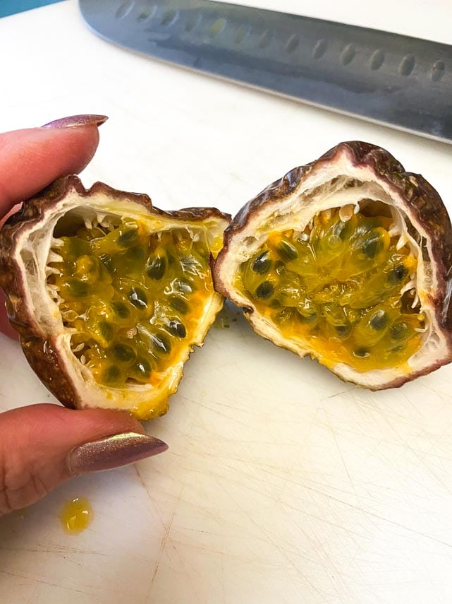 passionfruit cut open to reveal flesh and seeds