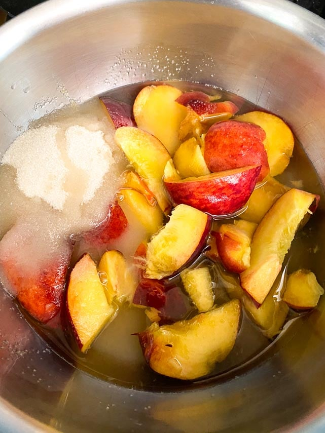 peaches, sugar and water in pan