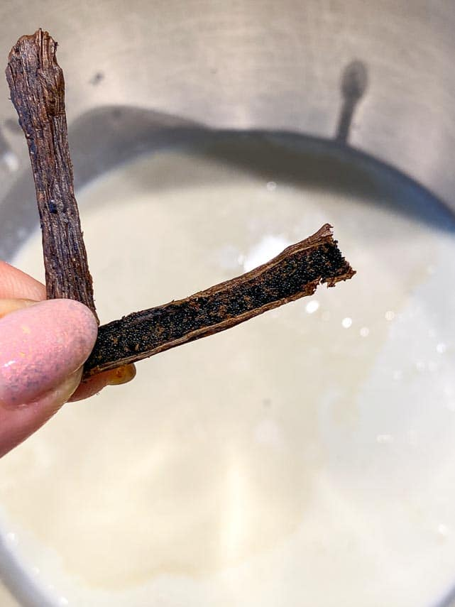 showing the inside of a vanilla bean to expose seeds