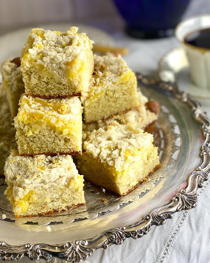 stack of Low FODMAP Lemon Crumb cake on silver platter, on white linen