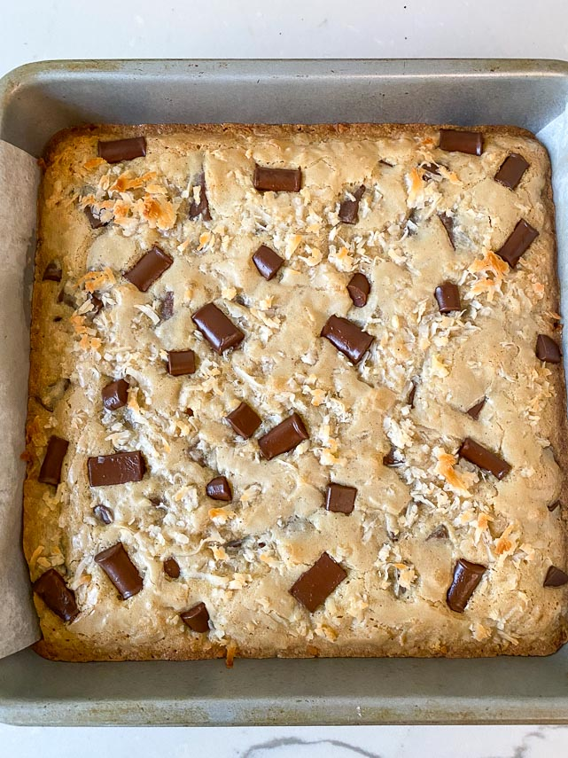 coconut chocolate blondies baked, still in square pan