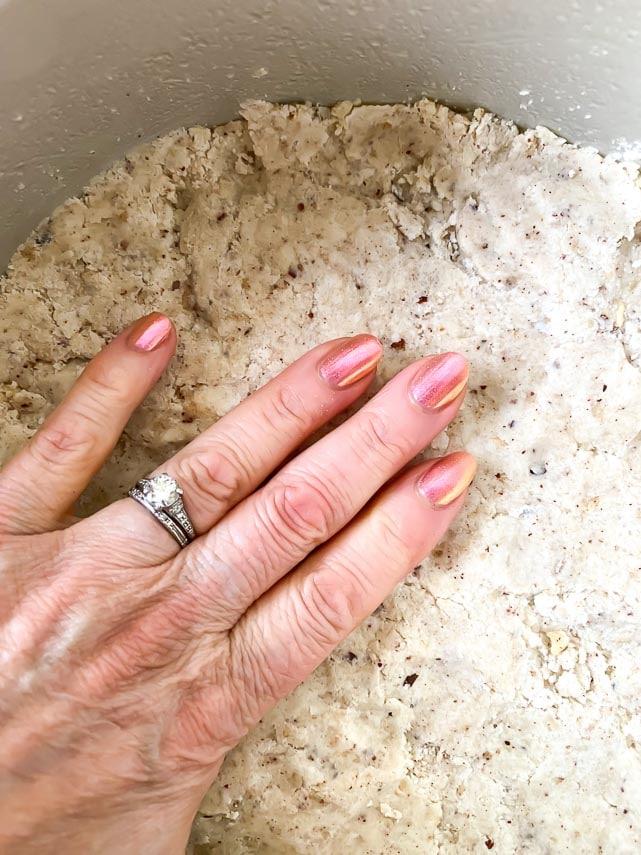 patting hazelnut crust into round pan