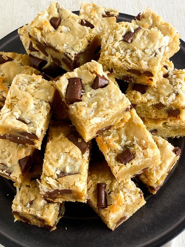 pile of cookie dough blondies on dark plate