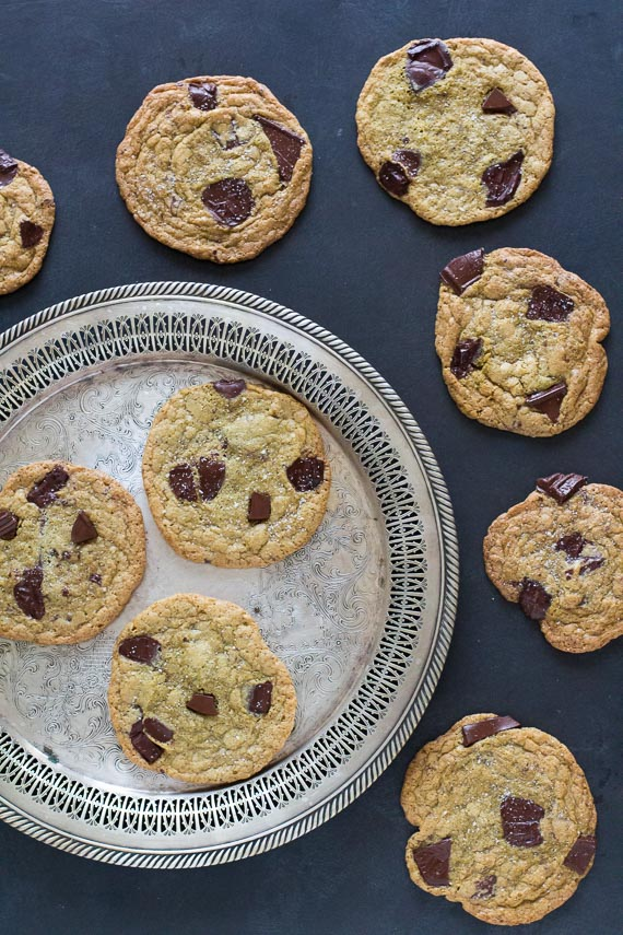 salted buckwheat chocolate chunk cookies on black table with silver tray