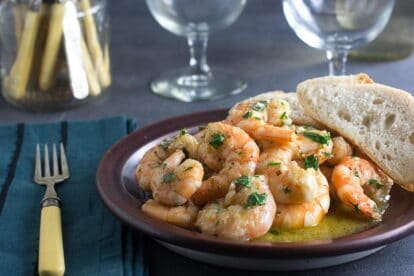 shrimp scampi in a brown plate