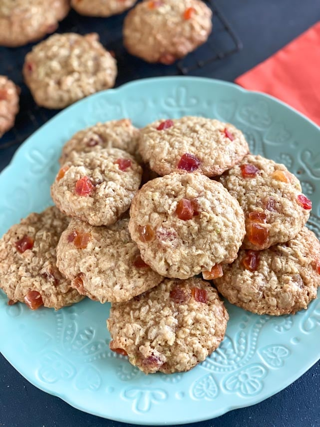 vertical image of pile of oatmeal cookies on an aqua plate