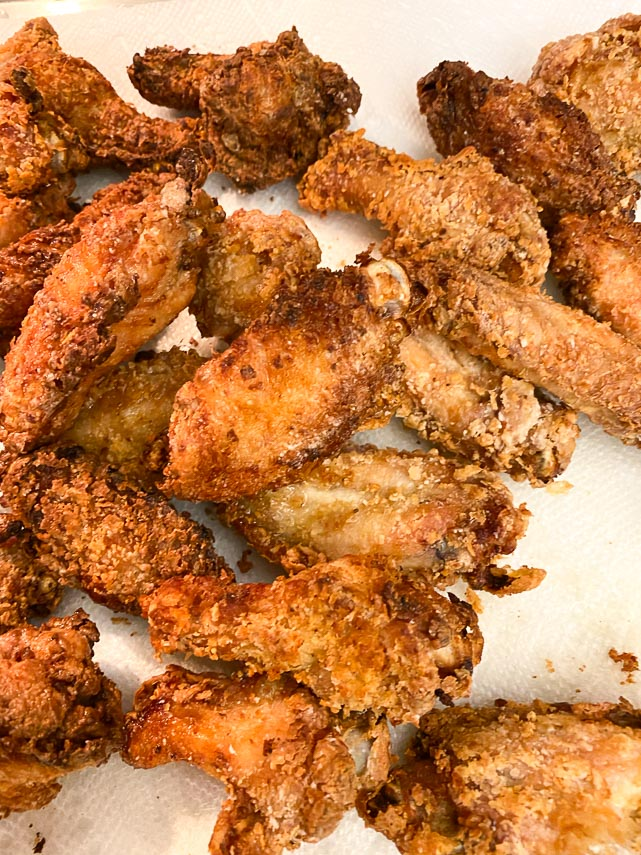 wings, fried and draining on paper towels