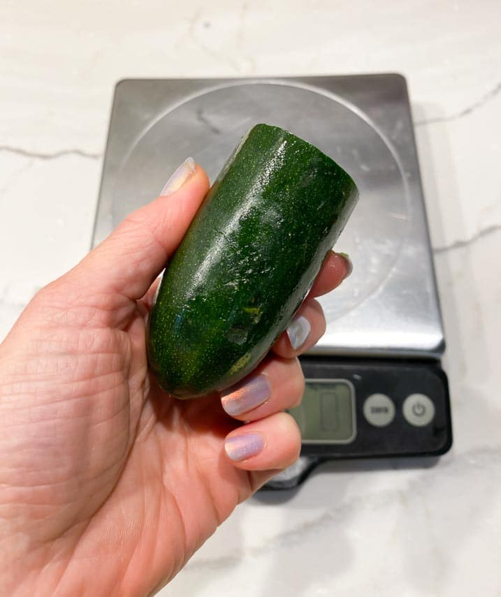 65 g of zucchini held in hand for perspective
