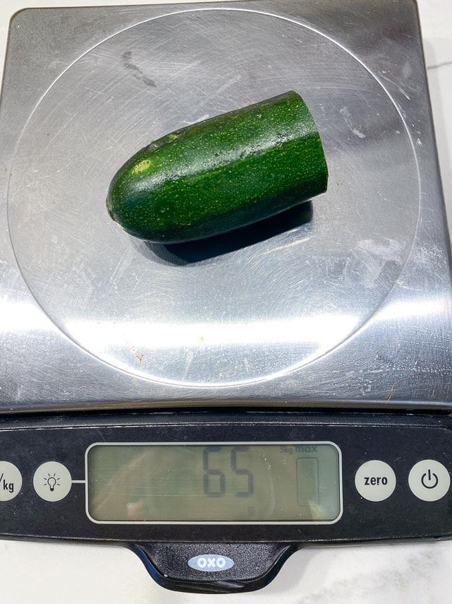 65 g piece of zucchini on digital scale