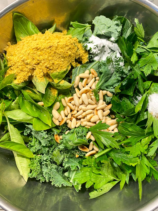 basil, kale, parsley, nutritional yeast, toasted pine nuts and FreeFod Garlic replacer in a stainless steel bowl