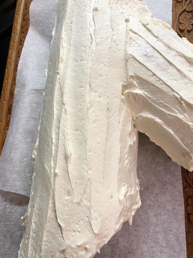 buche de Noel in the making; parchment paper protecting serving platter