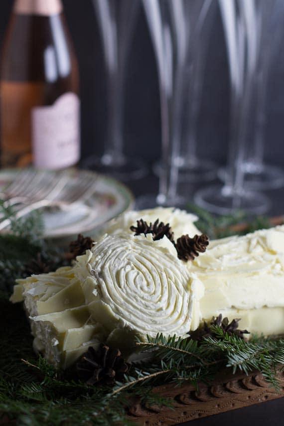 closeup of white chocolate buche de Noel showing rings of cut log end