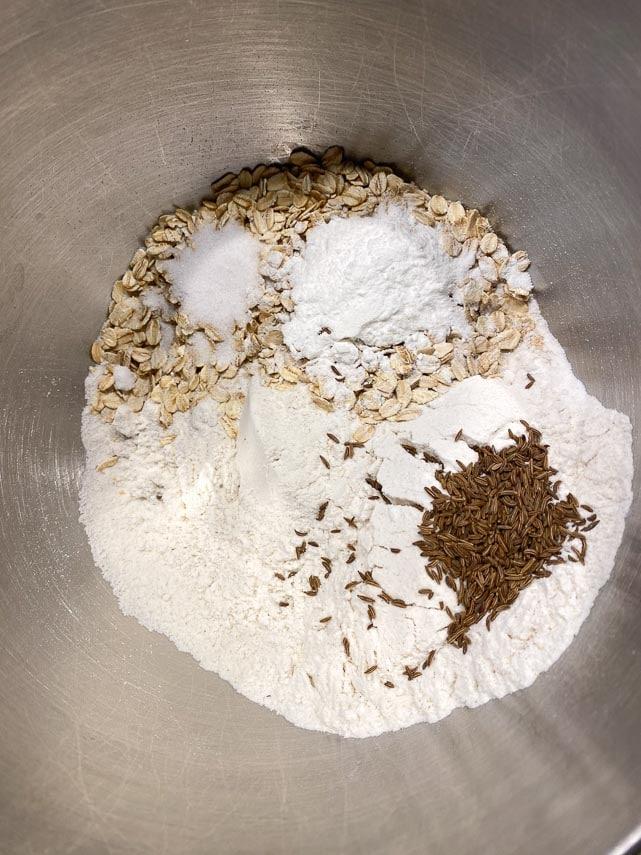 dry ingredients for beer bread in stainless steel bowl