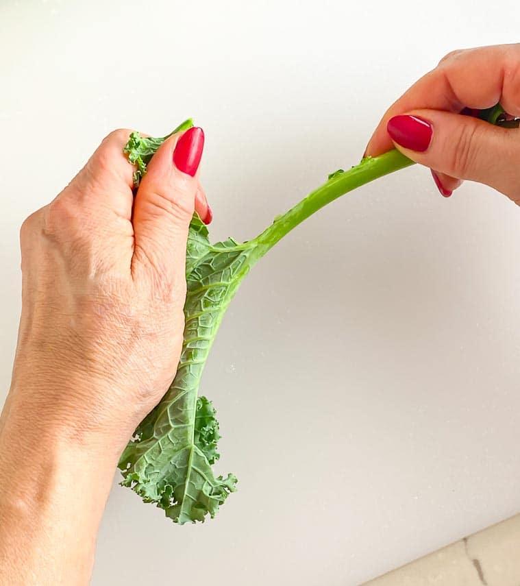 using hands to de-rib kale