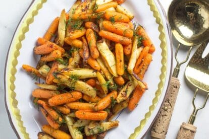 Low-FODMAP-Carrots-Parsnips-with-Dijon-butter-on-oval-platter-with-serving-spoon-and-fork