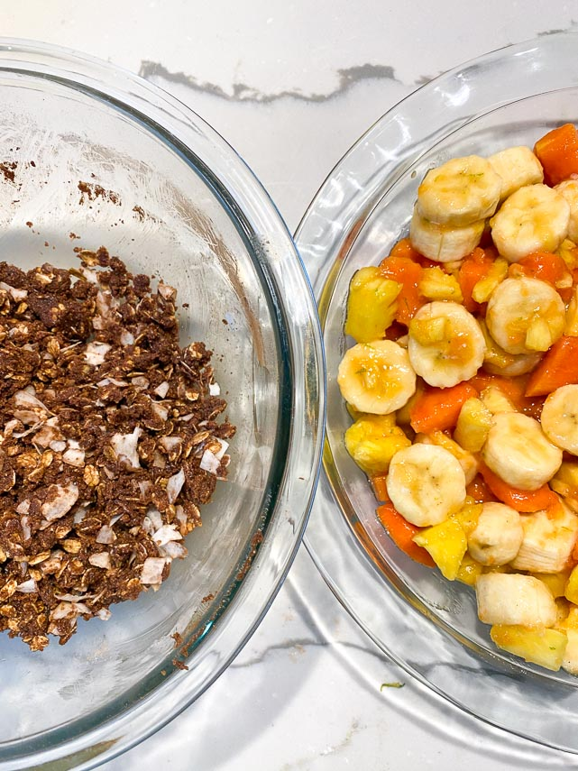 Tropical-chocolate-crisp-topping-in-left-in-glass-bowl-fruit-filling-on-right