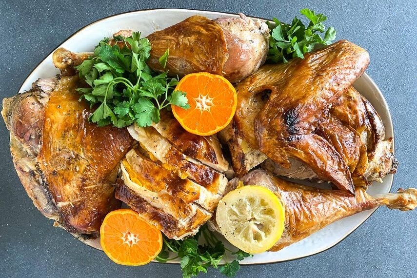 Citrus Brined turkey on a white oval platter