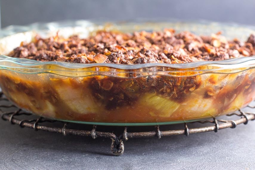 side-view-of-tropical-crisp-in-glass-pie-dish-cooling-on-rack