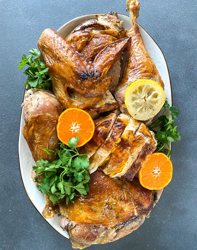 Citrus brined turkey, carved, on oval platter