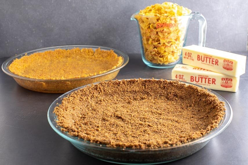 low-FODMAP-cereal-crumb-crusts-with-cup-of-cornflakes-and-sticks-of-butter-in-background