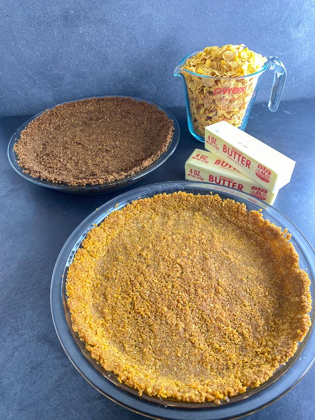 low-FODMAP-cereal-crumb-crusts-with-cup-of-cornflakes-and-sticks-of-butter-in-background-vertical-image-2