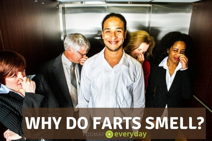 Young man in elevator smiling because he just farted and everyone in the elevator is holding their nose.