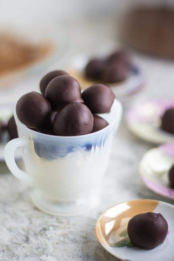 low FODMAP chocolate dipped truffles in a white footed dish