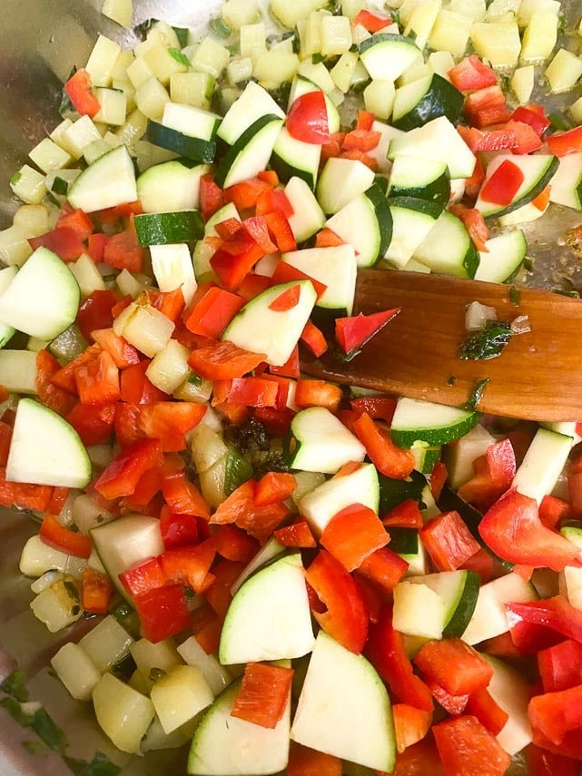 sauteeing-vegetables-for-frittata-wooden-spatula-in-pan