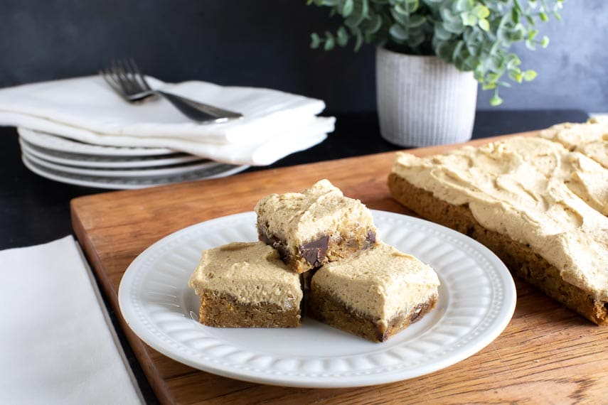 espresso-buttercream-covered-bars-on-white-plate-and-on-wooden-board-1