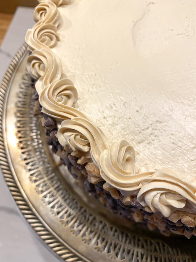 espresso-buttercream-piped-through-tip-on-cake-edge