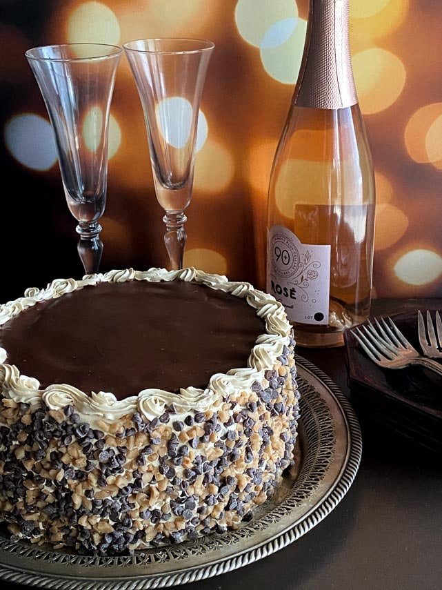 gorgeous-vertical-image-of-Low-FODMAP-Mocha-Toffee-Crunch-Cake-on-silver-platter