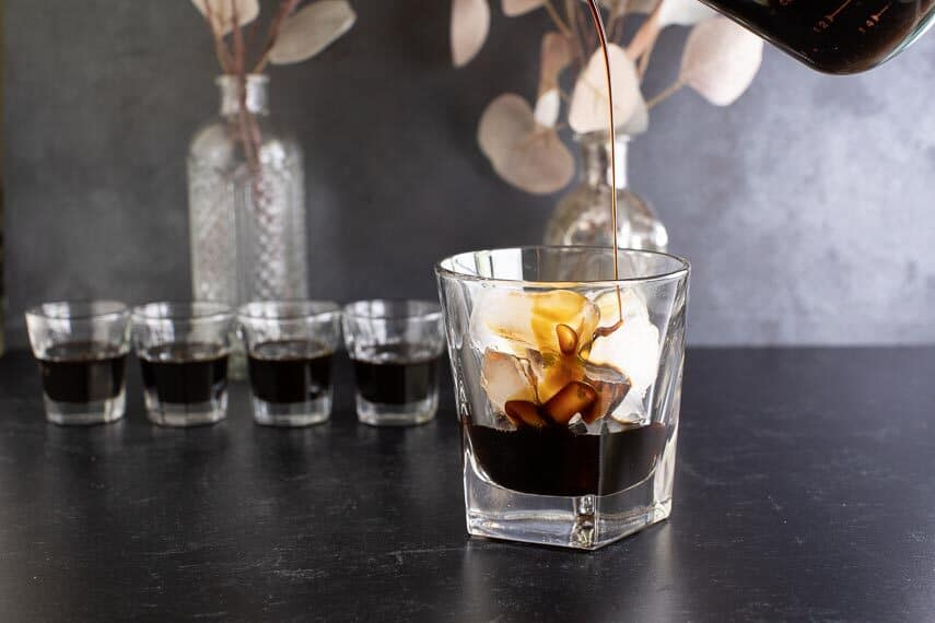 low-fodmap-coffee-liqueur-being-poured-over-ice-in-glass