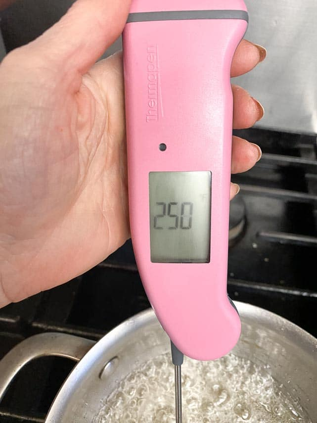 pink-thermopen-testing-sugar-syrup-on-stove