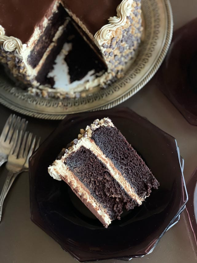 slice-of-low-FODMAP-Mocha-toffee-crunch-cake-on-dark-plate