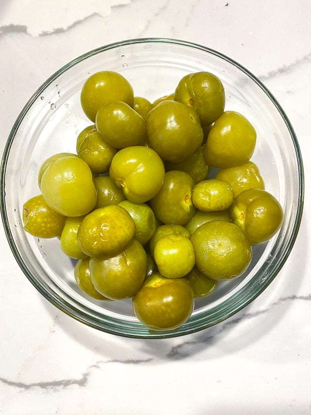 canned-tomatillos-drained-in-glass-bowl