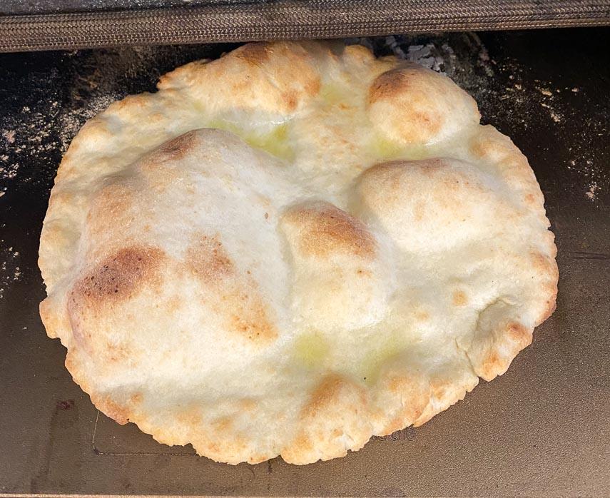 par baked pizza 2.0 crust on baking steel in oven