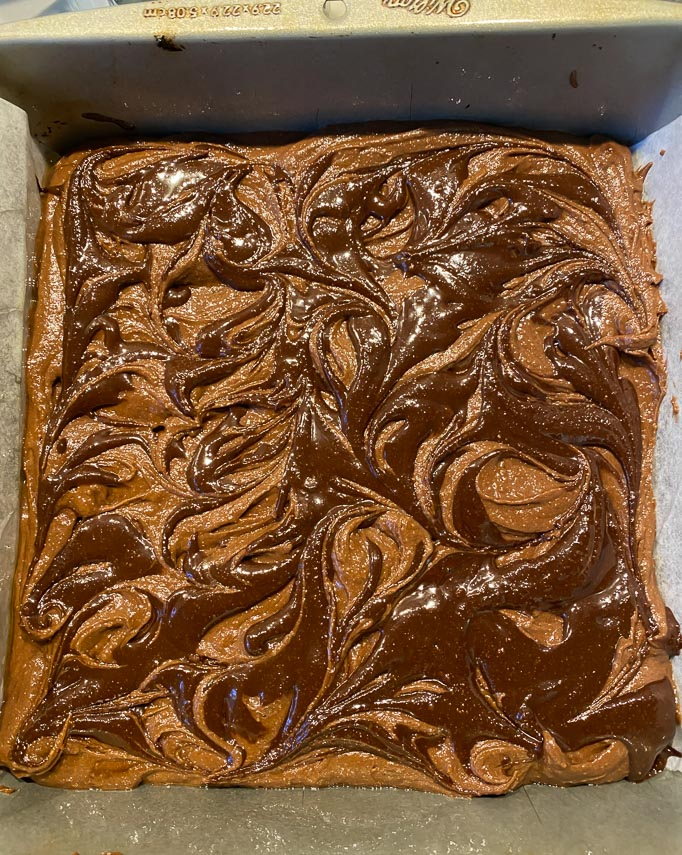 Nutella swirled into raw brownie batter in pan before baking