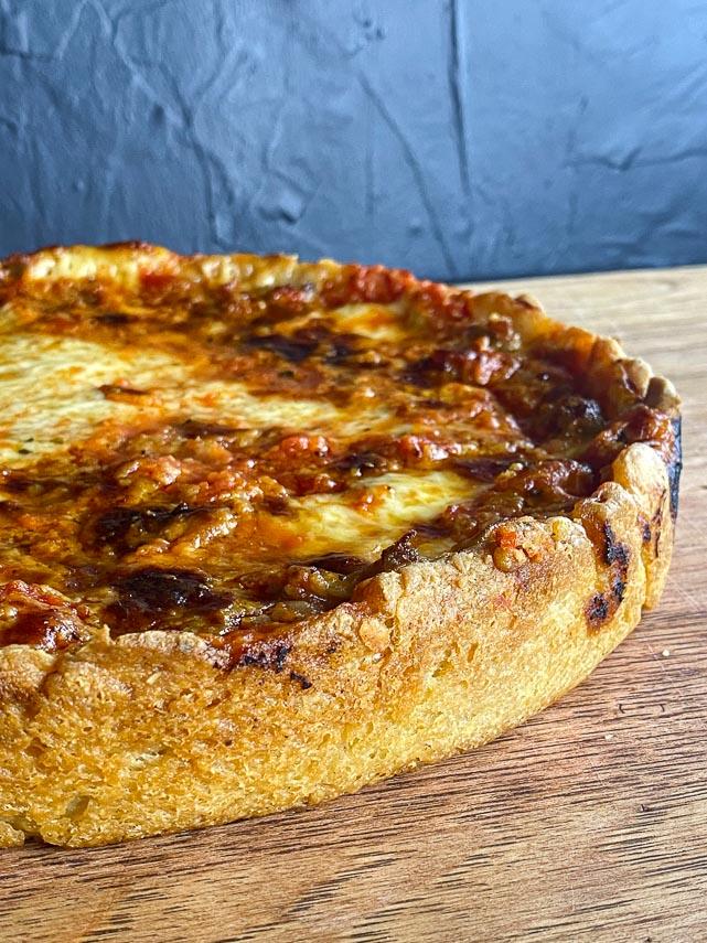 closeup deep dish pizza crust