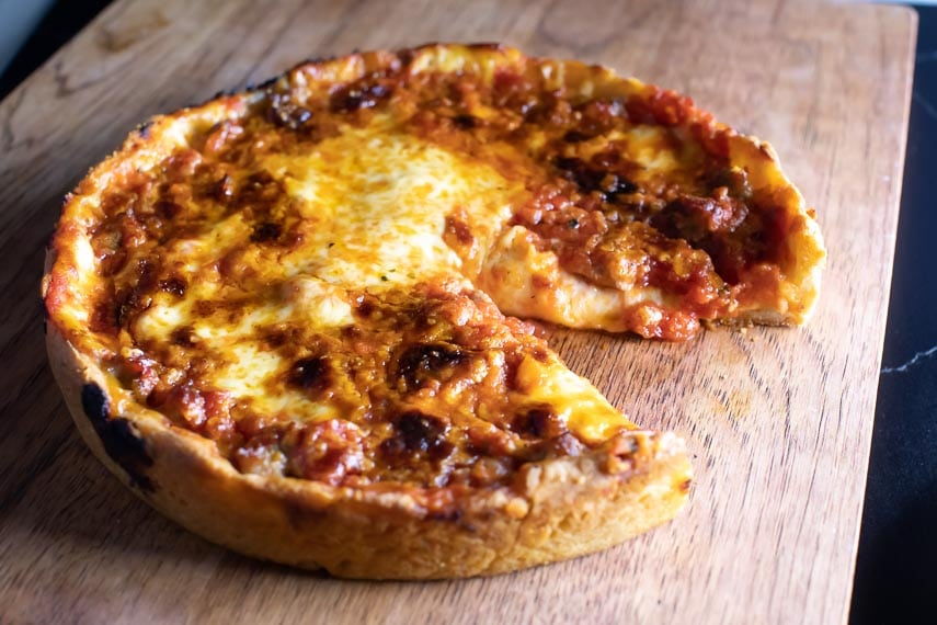 deep-dish low FODMAP pizza on board wedge cut out