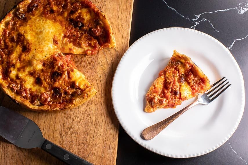 low FODMAP DEEP DISH PIZZA on board and on white plate