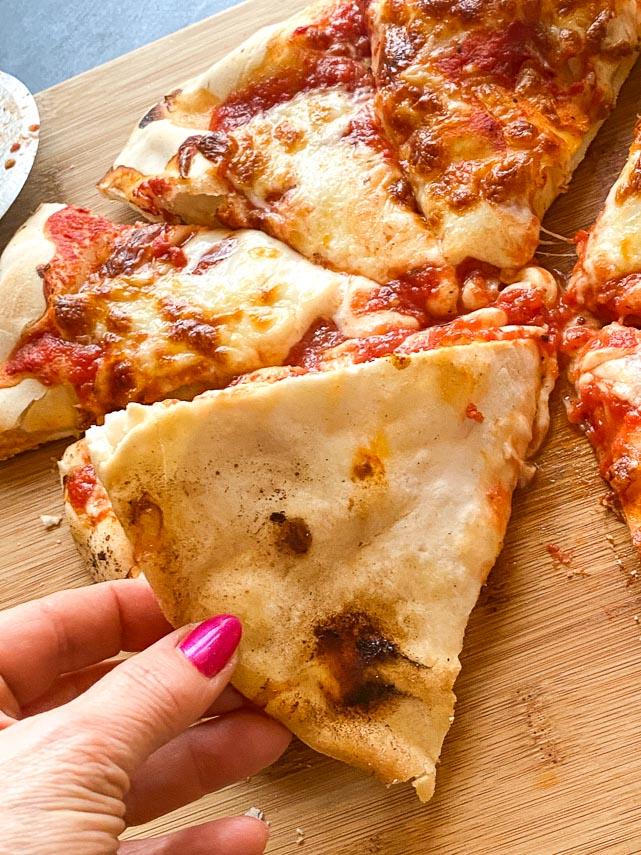 Bottom of Caputo GF pizza crust slice