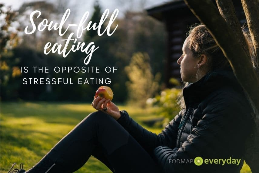 The words Soul-full eating is the opposite of stressful eating overlaid a photo of a young woman sitting with her back against a tree eating an apple.