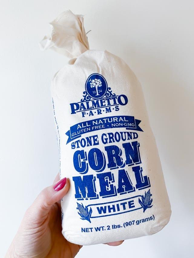 bag of cornmeal held in hand
