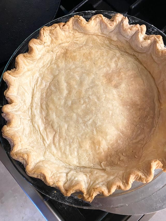 cream cheese crust blind baked in glass pie dish, fluted edges